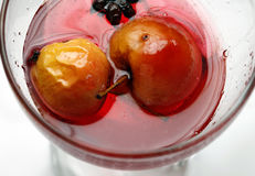 Red apple in rose syrup Stock Photos