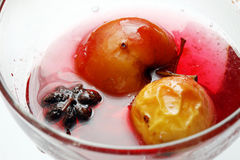 Red apple in rose syrup Stock Photo