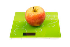 Red apple on scales Royalty Free Stock Images