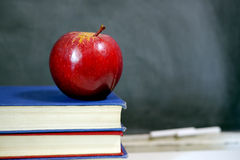 Red apple on school textbook Royalty Free Stock Photos