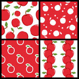 Red Apple Seamless Patterns Set. Collection of four seamless patterns with red apples, isolated on white and red background. Useful also as design element for Royalty Free Stock Photography