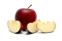 Red apple with segments. On a white background Royalty Free Stock Image