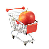 Red apple in a shipping cart Royalty Free Stock Photography
