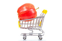 Red apple in shopping cart Stock Image