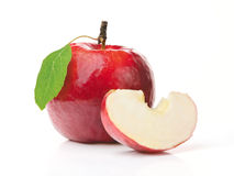 Red Apple and a Slice. A Whole Apple with Green Leaf and a Slice. Isolated on White Background Stock Images