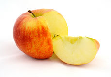 Red apple with slice Stock Images