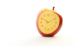 Red apple Slice Clock idea concept Stock Photography