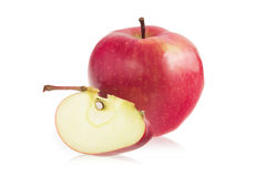 Red apple and a slice of red apple Stock Photos