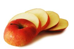 Red apple slices Stock Images