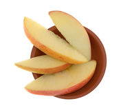 Red apple slices in a small clay bowl Stock Image