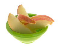 Red apple slices in a small green bowl Stock Photo