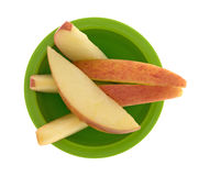 Red apple slices in a small green bowl Royalty Free Stock Image