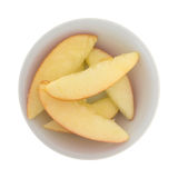 Red apple slices in a small white bowl Royalty Free Stock Photo