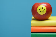 Red apple with a smiley face Stock Photo