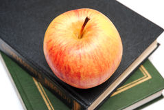 Red apple on snack of books Royalty Free Stock Images