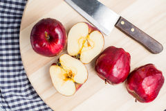 Red apple with some cut in half and knife Royalty Free Stock Images