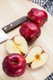 Red apple with some cut in half and knife.  Royalty Free Stock Photo