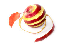 Red apple in a spiral of peel Royalty Free Stock Photo
