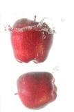 Red apple splash Stock Image