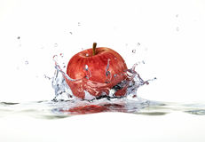 Red Apple Splashing Into Water. Stock Photography