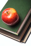 Red apple on stack of book Stock Photos