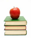Red apple on a stack of books Royalty Free Stock Images
