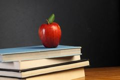 Red apple on stack of books Royalty Free Stock Images