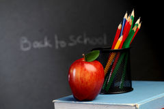 Red apple on stack of books Royalty Free Stock Image