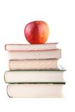 Red apple on a stack of books Royalty Free Stock Photography