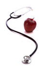 Red Apple and a Stethescope Royalty Free Stock Photos