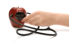 A red apple and a stethoscope Royalty Free Stock Photo