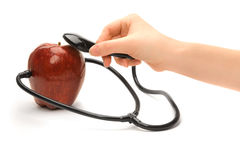 A red apple and a stethoscope Stock Photos