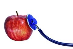 Red apple and stethoscope Stock Photo