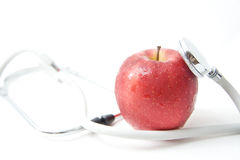 A red apple and stethoscope Stock Photography