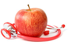 Red apple and stethoscope Stock Image