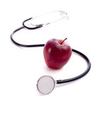 Red Apple and a Stethoscope Royalty Free Stock Images