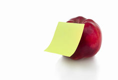 Red apple with stiker note Royalty Free Stock Images