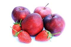 Red apple and strawberry. Apple and strawberry on white background Royalty Free Stock Photos