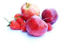 Red apple and strawberry. Apple and strawberry on white background Royalty Free Stock Photo