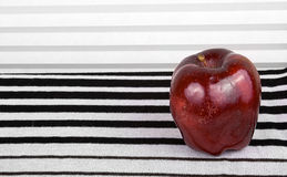 Red apple on the stripey background Royalty Free Stock Photo