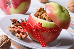 Red apple stuffed with nuts and raisins close up horizontal Stock Photography