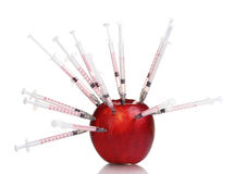 Red apple and syringes Royalty Free Stock Image
