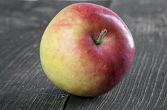 Red apple on the table. Red apple on the  wooden table Royalty Free Stock Photography