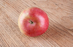 Red apple on the table. Red apple on the  wooden table Stock Photos