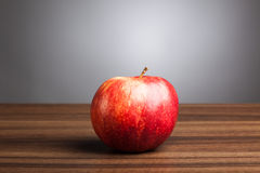 Red apple  on table, gray background Stock Image