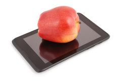 Red apple on a tablet PC Clipping path Stock Image