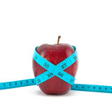 Red apple with tape Royalty Free Stock Photography