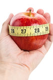 Red apple and Tape Measure Royalty Free Stock Image