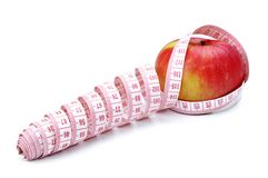 Red apple and Tape Measure Stock Images