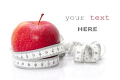 Red apple and tape measure. Isolated on white (with sample text Royalty Free Stock Photography